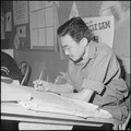 Heart Mountain Relocation Center, Heart Mountain, Wyoming. A young Nisei artist works on a letterin . . . - NARA - 539154.tif