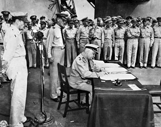 Conrad Helfrich - Tokyo Bay, Japan – Surrender of Japanese aboard USS Missouri. Luitenant-Admiraal C.E.L. Helfrich, representing the Kingdom of the Netherlands, signs the instrument of surrender. He is being watched by a compatriot and by General Douglas MacArthur, Supreme Allied Commander, at the microphone.