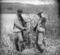 Herman Bohlman and William L. Finley inspecting fish at the Klamath Marsh (3945309215).jpg