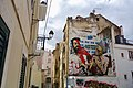 Hipster with a selfie stick punished by old Lady • The Greatest Graffiti in Lisbon, Portugal (49667017793).jpg