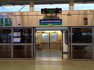AirTrain JFK - Platform screen doors (shown here at Howard Beach station) are present on all AirTrain JFK platforms