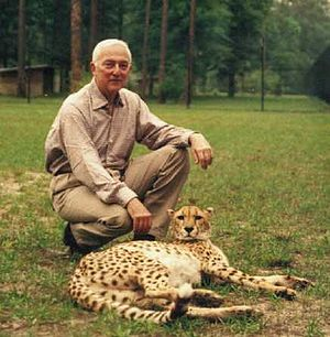 White Oak Conservation - Howard Gilman poses with a cheetah.