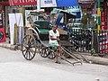 Human powered rickshaw (7169524845).jpg