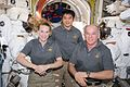 ISS-48 Kate Rubins, Takuya Onishi and Jeff Williams with spacesuits inside the Quest airlock.jpg