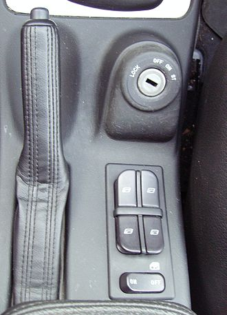 Power window - Window controls on center console between front seats (2005 Saab 9-5)