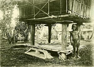 Kedayan - A Kedayan man, standing underneath a rice barn.