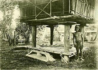 Kedayan - A Kedayan man, standing underneath a rice barn.