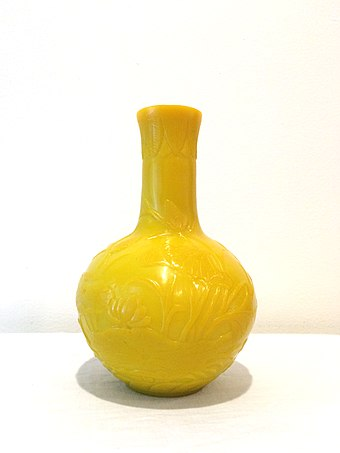 "A Daoguang period Peking glass vase. The vase is colored in ""Imperial Yellow"", which was popular due to its association with the Qing imperial dynasty. Imperial Yellow Peking Glass Vase.jpg"