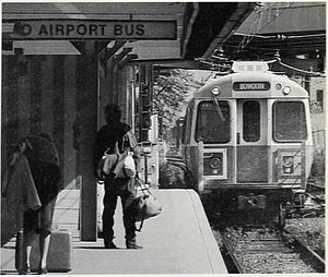 Airport (MBTA station) - An inbound train arrives at the 1952-built Airport Station in 1985