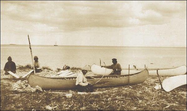 Innu making canoes near Sheshatshiu, ca. 1920