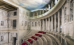 "Teatro Olimpico - The ""cavea"", or seating area. The ""loggia"" or columned portico at the top conceals a staircase (visible in Scamozzi's floorplan) which originally served as the entrance to the cavea."