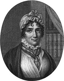 Engraving of woman, showing her head and shoulders. She is wearing 19th-century clothing and a white cap. A bookshelf is in the background.