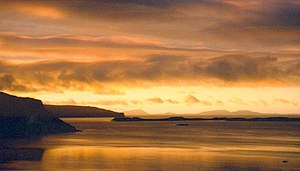 Isay - An October sunset over Isay, with the Outer Hebrides in the distance.