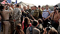 Israeli Deputy Prime Minister and Minister of Defense Ehud Barak, center, speaks with a group of U.S. and Israeli soldiers amid a crowd of reporters during a visit to a ballistic missile defense position near 121023-F-OT114-001.jpg
