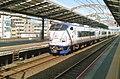 JRW 281 Hello Kitty Haruka train passing Shin-Imamiya Station 190505.jpg