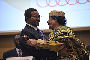 African Union - Muammar Gaddafi embracing Tanzanian President Kikwete after assuming the chairmanship.