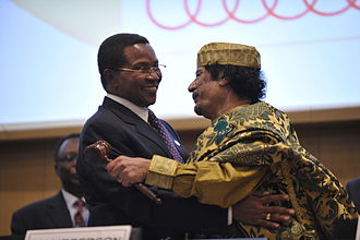 African Union - Muammar Gaddafi embracing Tanzanian President Kikwete after assuming the chairmanship