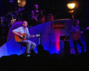 "Luis Conte - Luis Conte (rear), plays with James Taylor's ""Band of Legends."""