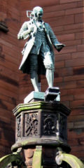 A statue at the original James Watt College building marks the site of his birthplace.