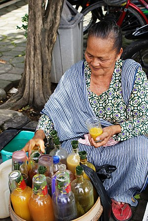 Jamu - An elderly mbok jamu gendong, jamu-seller woman.