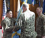 Joint Task Force Guantanamo Commander, Navy Rear Admiral John C. Ring, hands off the Joint Detention Group guideon to the incoming JDG Commander, Army Colonel Steven G. Yamashita - 180627-Z-PV458-0038.JPG