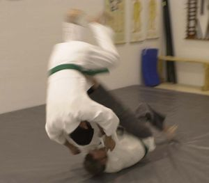Hard and soft (martial arts) - A tomoenage front sacrifice throw used against a front-pushing attacker.