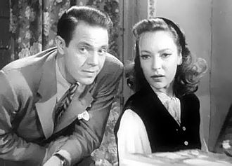 Louis Hayward - Louis Hayward and June Duprez in And Then There Were None (1945).