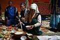 Kazakh woman serving tea.JPG
