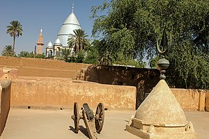 Khalifa House Museum - In the foreground: Cupula of the original Mahdi's Tomb. In the background: The new Mahdi's Tomb.