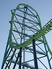 tall green framework for steel roller coaster