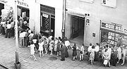 Queue waiting to buy toilet paper, a typical view in Poland in 1950s and 1960s.