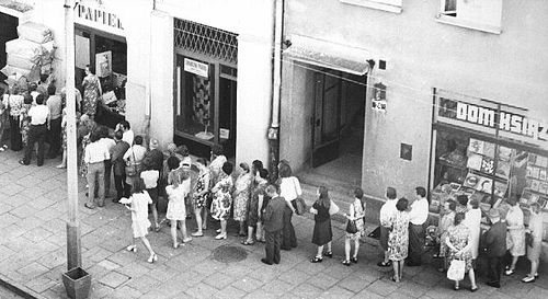 Queues waiting to enter state-run grocery stores in Warsaw and other Polish cities and towns were a typical sight in the 1950s and 1980s. The availability of food and goods varied at times, and the most sought after basic item was toilet paper. Kolejka.jpeg