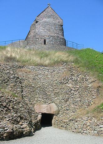 Grouville - Restoration work has reconstructed the entrance to the passage tomb of La Hougue Bie. The chapel sits on top of the mound