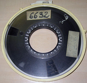 Spooling - Magnetic recording tape wound onto a spool may have contributed to the origin of the term