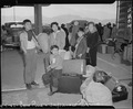Lone Pine, California. Evacuees of Japanese ancestry arrive here by train and await buses for Manza . . . - NARA - 536237.tif