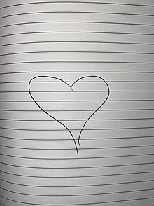 A drawn love heart on paper