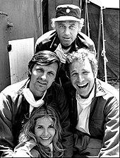 Alda (left of center) as Hawkeye Pierce in M*A*S*H, 1972