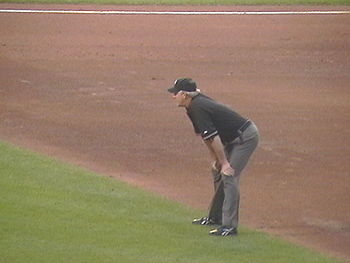 English: An umpire, the referee in baseball.