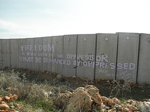 "Ni'lin -  A quote of Martin Luther King ""freedom is never given by the oppressor; it must be demanded by the oppressed"" written on the separation wall in Ni'lin by International Solidarity Movement activist, February 2012"