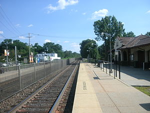 Mahwah station - The 1913 station building at Mahwah is visible on the right in July 2011.