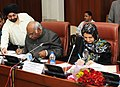 Mallikarjun Kharge and the Minister of Labour, Social Affairs, Martyrs and Disabled, Afghanistan, Ms. Amena Afzali signing the Twining Agreement between Ministry of Labour & Employment.jpg