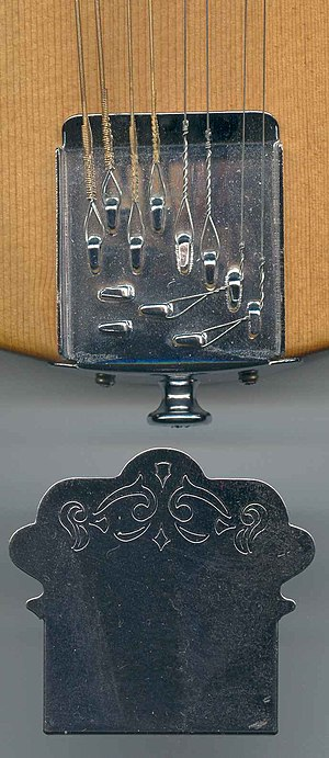 Tailpiece - Mandolin tailpiece, which simply anchors the strings solidly