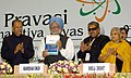 Manmohan Singh releasing the Publications of the Ministry of Overseas Indian Affairs; Launch of Helpline of Overseas Indian Workers at the inaugural ceremony of the 6th Pravasi Bharatiya Divas-2008, in New Delhi.jpg