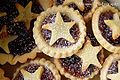 Many mince pies with star decoration dusted with confectioner's sugar.jpg