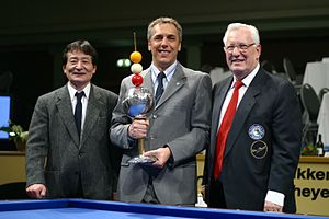 "Marco Zanetti - Winner as ""Player of the Year 2003"". Left: Nobuaki Kobayashi Right: Raymond Ceulemans"