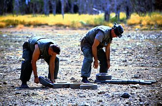 U.S. Marines stack up landmines for disposal in July 1997. Marines stack mines for disposal.jpg