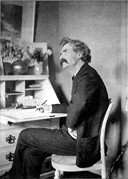 Mark Twain pondering at desk