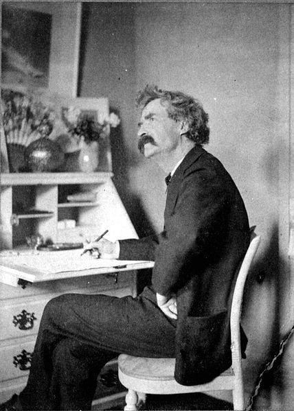 File:Mark Twain pondering at desk.jpg