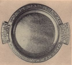 "Bronze matzo plate inscribed """"Ha Lachma Anya"" (""This is the bread of affliction that our ancestors ate in Egypt,"") the opening words of the ""Maggid"" (Retelling). Design: Maurice Ascalon."