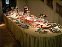 A formally laid table set with a Meissen dinner service